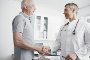 Middle aged man shaking doctor's hand